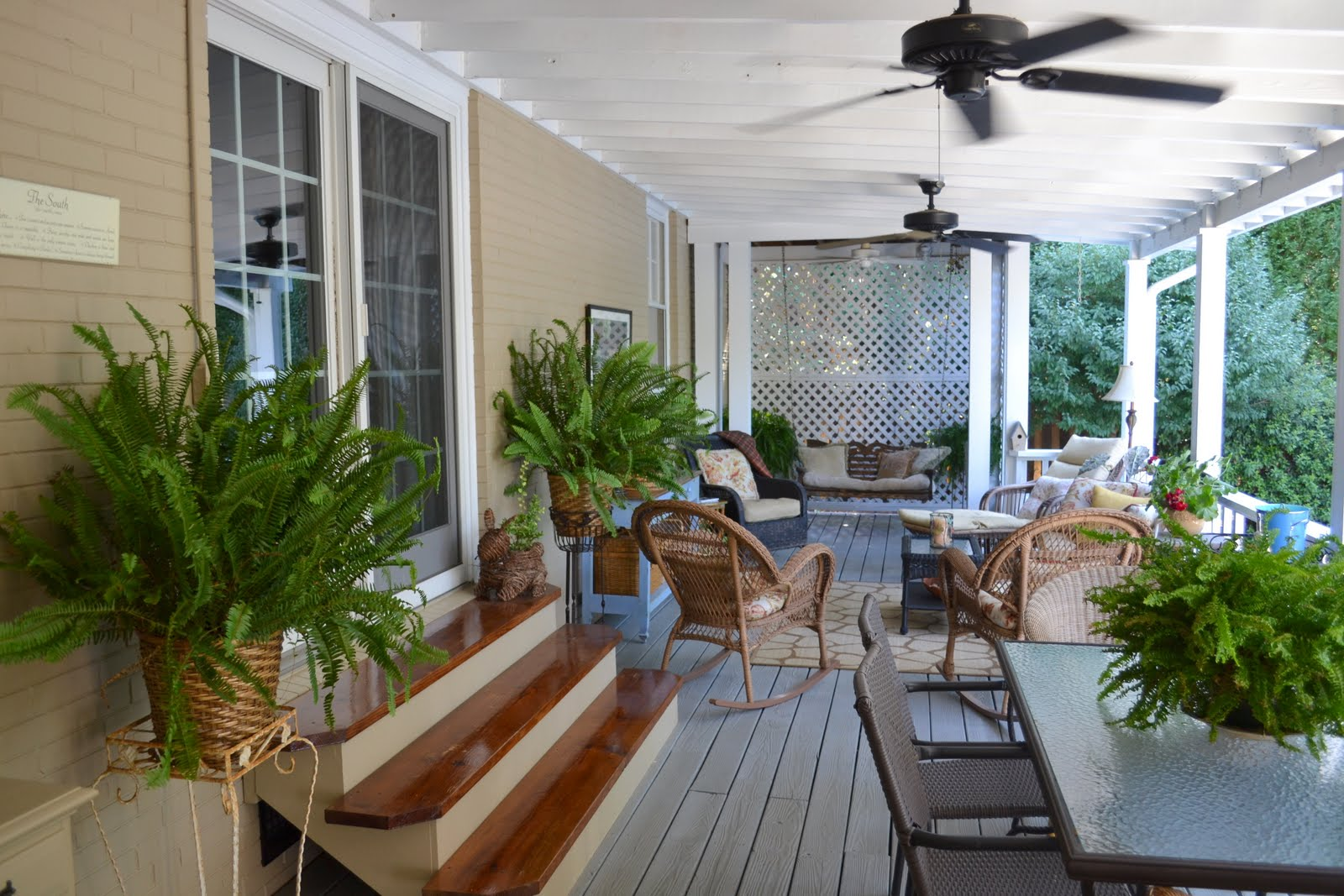 A Covered Back Porch Filled With Vintage Goodies