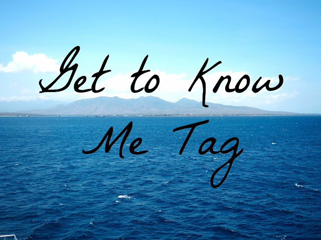Get to Know Me Tag text on ocean background