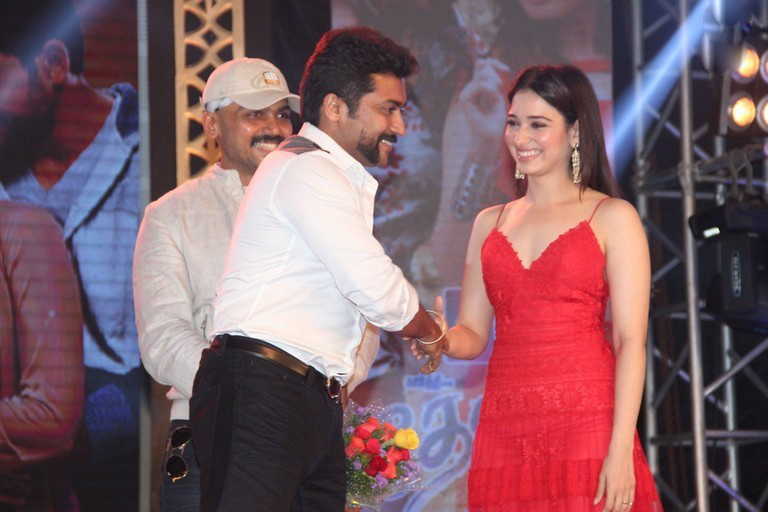 Tamanna and Suriya at the launch of Thozha Audio. Tamanna red hot in Thozha, Oopiri, Red Dress Tamanna, Tamanna in Oopiri, Tamanna in Thozha, red hot , Hot Tamanna in Thozha-Oopiri audio Launch. hot and sensual Tamanna in Thozha, hot and Sensual tamanna in OOpiri