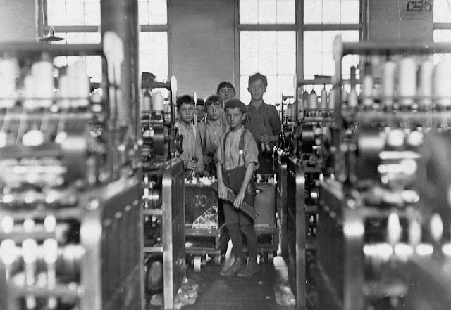 Young doffers in Mollahan Mills in Newberry, South Carolina, on December 3, 1908. A doffer is someone who removes, or