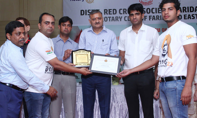 Shaheed Bhagat Singh Brigade member honored by District Red Cross Society Faridabad