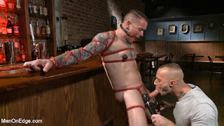 CMNM: naked man being edged by clothed men