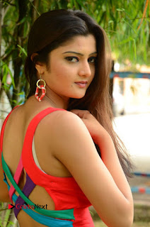 Actress Poojitha  Pictures in Red Short Dress at Bullet Movie Opening  0012.JPG