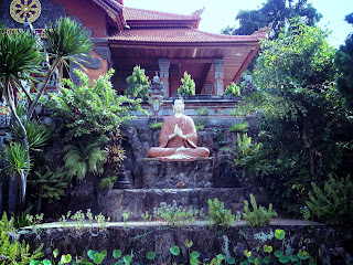 Buddha Statue In The Middle Of The Garden At Brahmavihara Arama Monastery North Bali