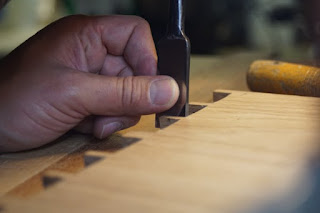 An image of a hand holding a chisel