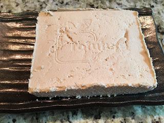 Photo of a block of homemade tofu on a tray. https://trimazing.com/