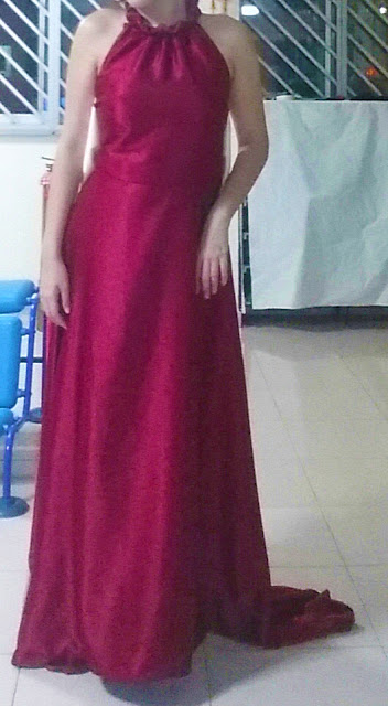 Front view of the halter neck wine red evening gown