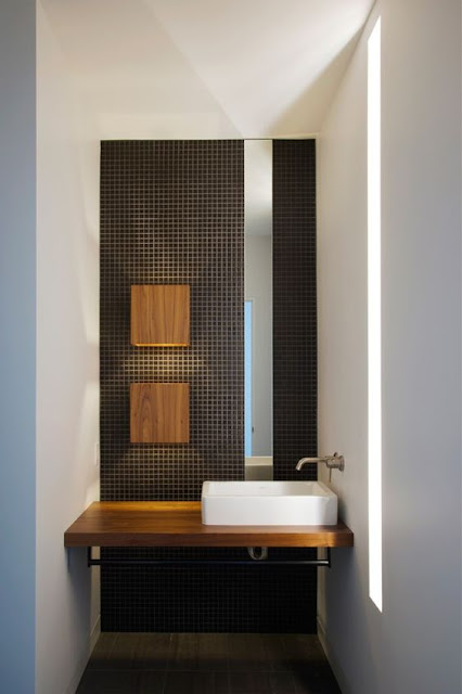 black and white bathroom, black mosaic tile, wood in bathroom,