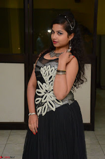 Shrisha Dasari in Sleeveless Short Black Dress At Follow Follow U Audio Launch 026.JPG
