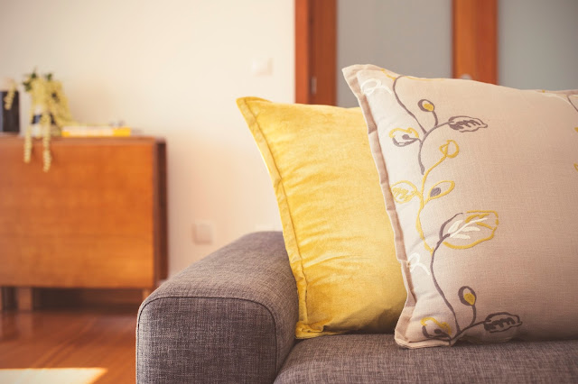 embroidered pillows grey and yellow living room