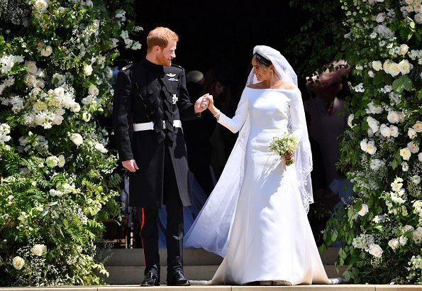 Markle wore a silk organza boat neck long sleeve wedding dress designed by famous British designer Clare Waight Keller.