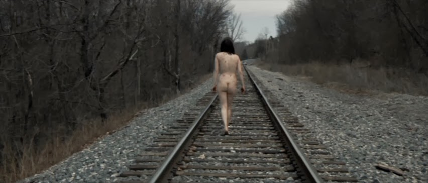 The opening credits are draped in it with an eye-openingly grim sequence of  an entirely naked woman (who's quite the ...