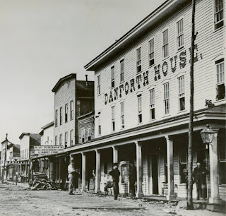 Late 1800s streetscape with hotel and businesses in Pithole Pennsylvania