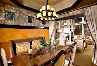 Fantastic Dining Space in the House with Iron Chandelier and Cozy Upholstered Dining Chairs near Wooden Table
