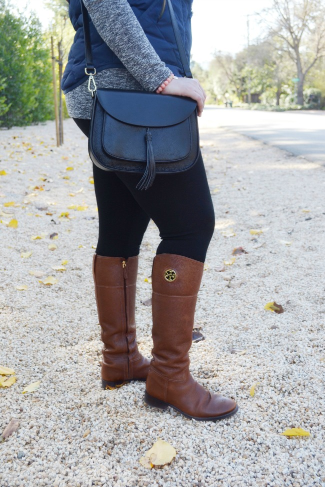 939172876ee The Classic Brunette  Puffer Vest And Tory Burch Riding Boots + A ...