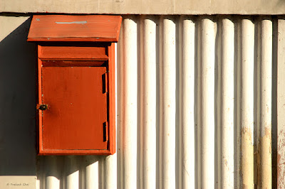A Minimalist Photo of a Brown Letter Box used for the Contact Us Section