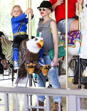 Bird of play! Gwen Stefani watches sort of a hawk as son Zuma spins on carousel eagle
