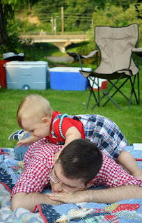 dad and toddler on picnic blanket on the 4th of july