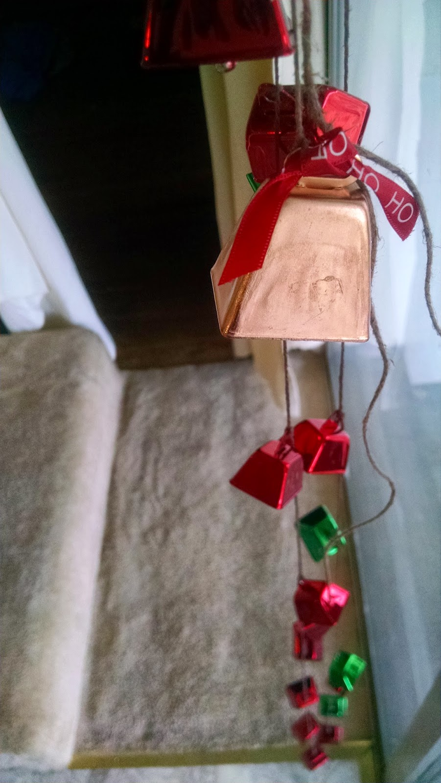 Santa Ribbon on Copper Cowbell in hanging cowbell decoration