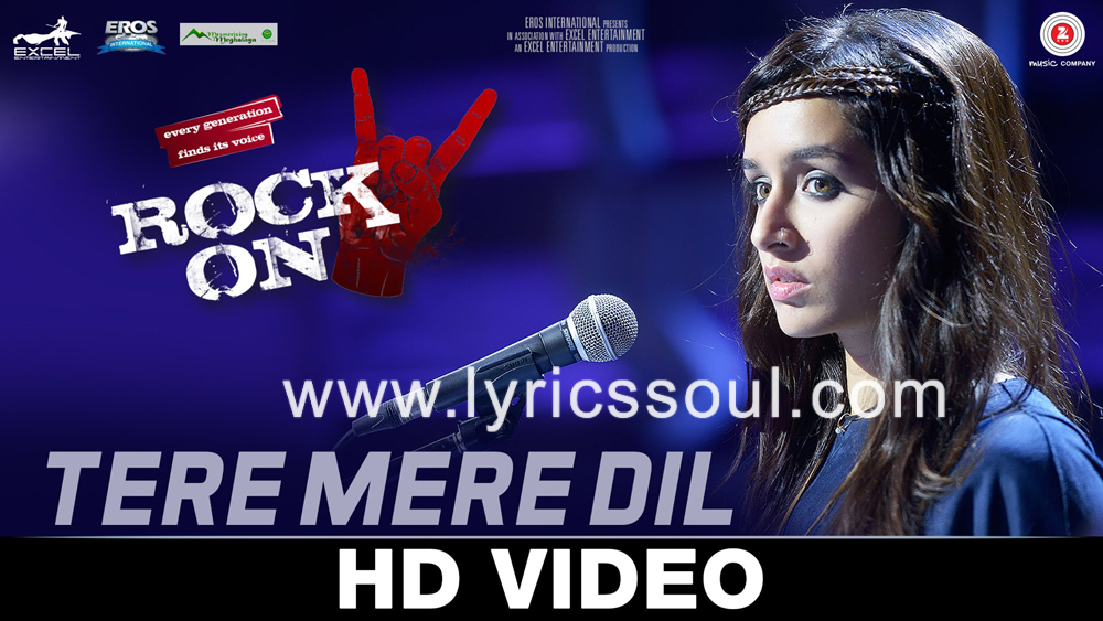 The Tere Mere Dil lyrics from 'Rock On 2', The song has been sung by Shraddha Kapoor, , . featuring Farhan Akhtar, Arjun Rampal, Purab Kohli, Shashank Arora. The music has been composed by Shankar-Ehsaan-Loy, , . The lyrics of Tere Mere Dil has been penned by Javed Akhtar,