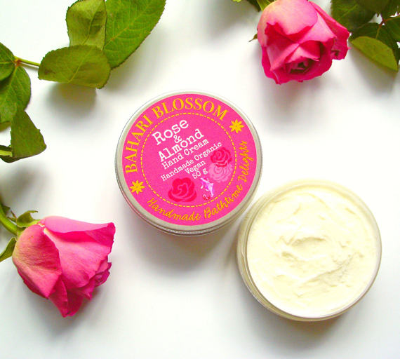 Pot of rose and almond hand cream with pink roses