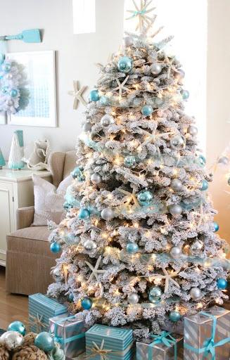 Snowy Flocked Coastal Christmas Tree Ideas with Blue Ornaments