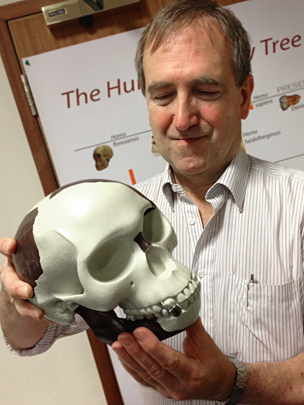 Photo. A nonsense: Chris Stringer holds a reconstruction of Piltdown Man's skull HOAX.