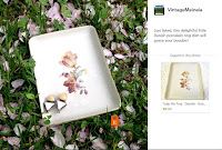 Trinket dish in grass with flower petals