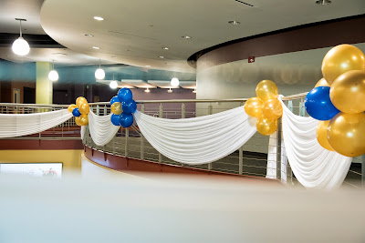 Preparation for the event. Hanging drapes and balloons