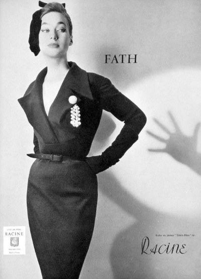 Model in black pencil skirt advertisement for Jacques Fath 1954 design. Photo by Guy Arsac