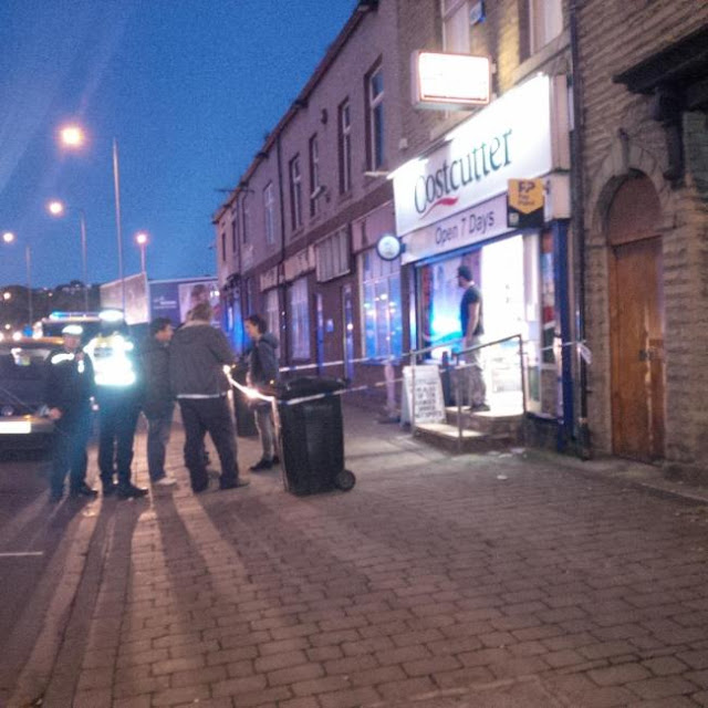 BREAKING UPDATED: Masked gang raid shop in Barkerend Road, Bradford, with axe and gun