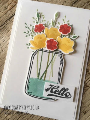 This picture shows a handmade card made using the Jar of Love stamp set by Stampin' Up! with Daffodil Delight and Poppy Parade flowers