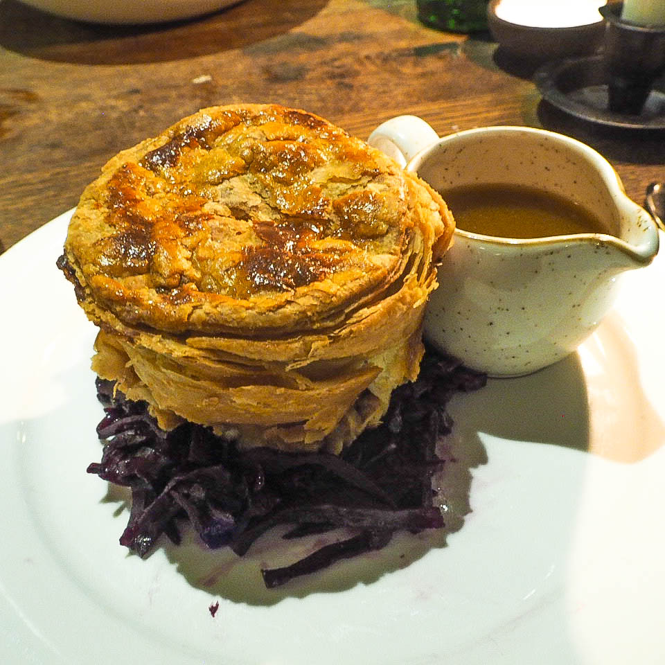 Venison pie with red cabbage and gravy