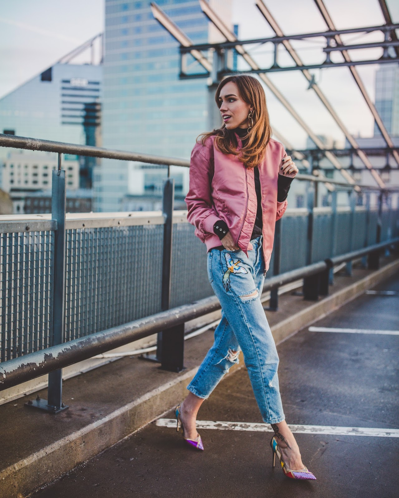 pink bomber jacket jeans pumps spring outfit