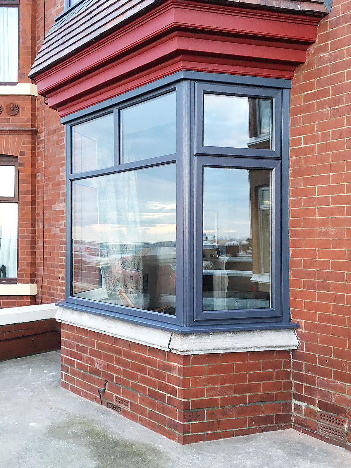 Full house of anthracite grey windows with red composite for House doors with windows