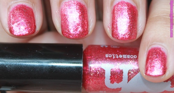 Red manicure with Rainbow Honey Nail Lacquer in Persephone