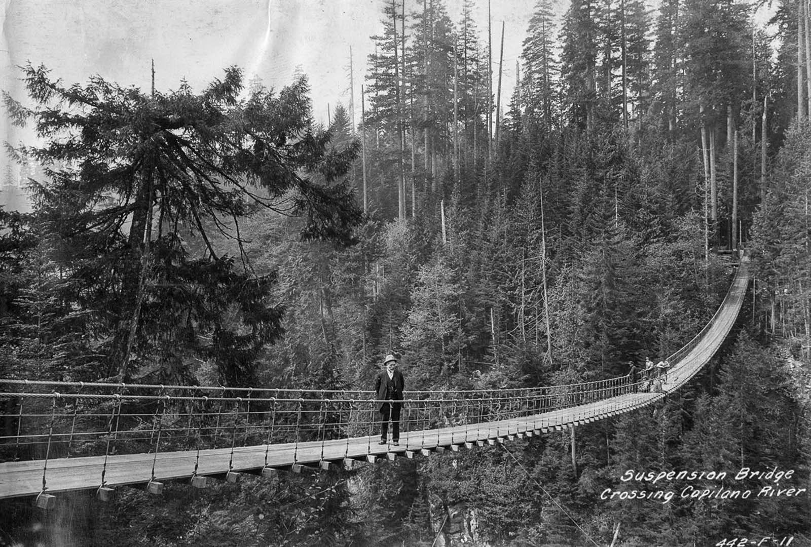 A suspension bridge over the Capilano River. 1919.