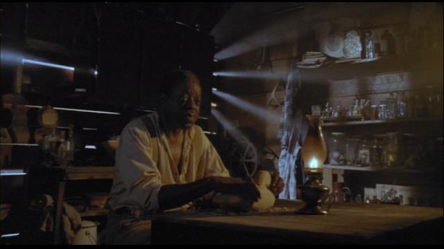 Harry Caesar as Felder Evans in FROM A WHISPER TO A SCREAM (1987).