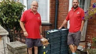 Postmen deliver crates full of birthday cards