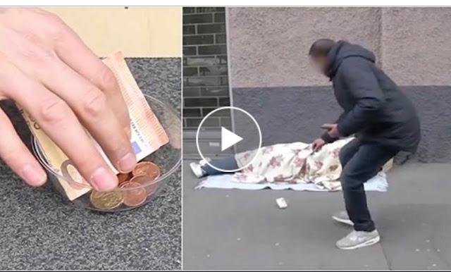 """تجربة اجتماعية بالفيديو..ماذا كنت ستفعل لو وجدت 100 يورو في صدقات""""مشرد"""" بلا مأوى ونائم؟""""شاهد لتعرف"""