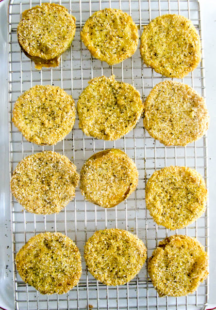 Southern Fried Green Tomatoes, crispy on the outside tender and meaty on the inside, yielding a tangy sweet flavor like no other.  Serve them stacked as an easy appetizer or serve them as an elegant side dish.