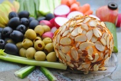 http://vedgedout.com/2013/11/15/kick-ace-extra-sharp-raw-vegan-holiday-cheddar-cheese-ball-virtual-vegan-potluck-edition/
