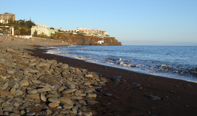 Praia Formosa with black sand and rolling stones