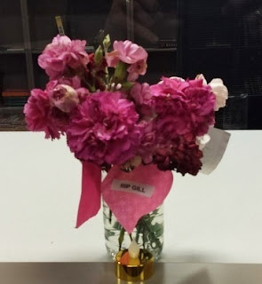 """pink carnations and a """"RIP GILL"""" card"""