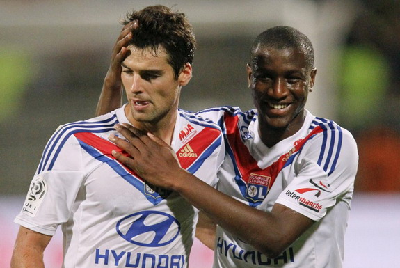 Yoann Gourcuff celebrates with Lyon teammate Henri Bedimo after scoring a goal against Nice