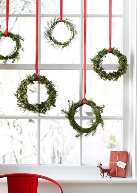 greenery wreaths in a window