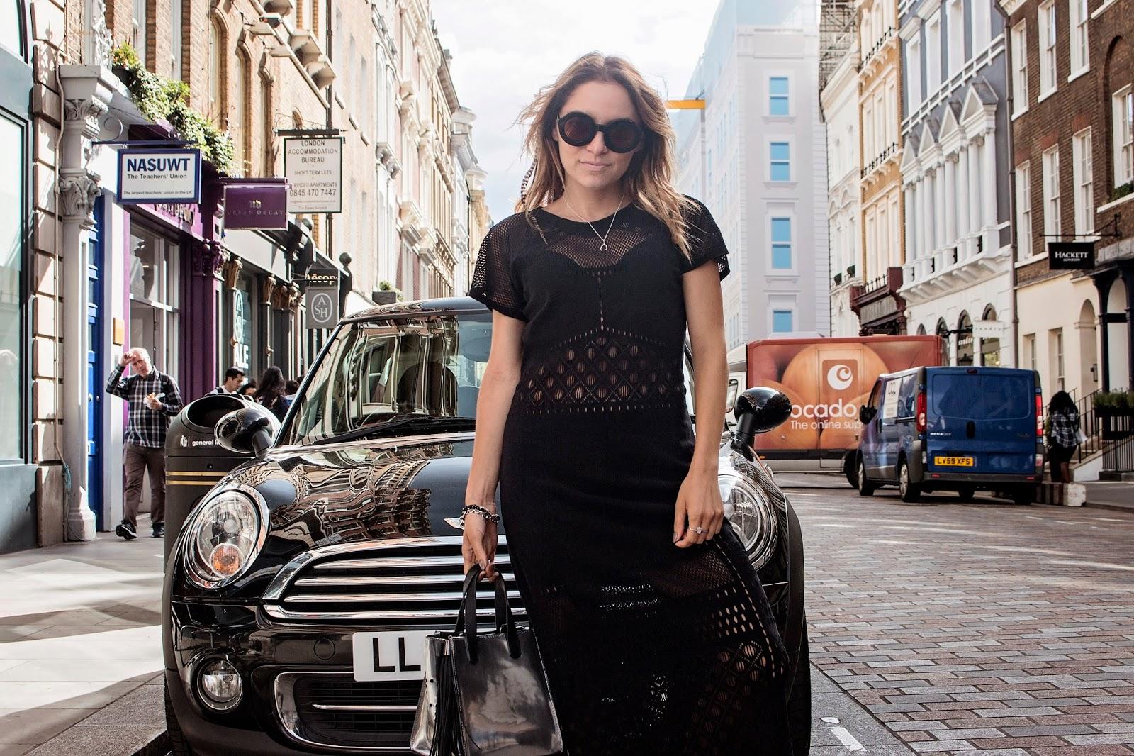 Whitney's Wonderland's Whitney Valverde UK Top Luxury Fashion Blogger wears Jets stretch knit midi dress, Wildfox round sunglasses, and Kurt Geiger flatform sandals.