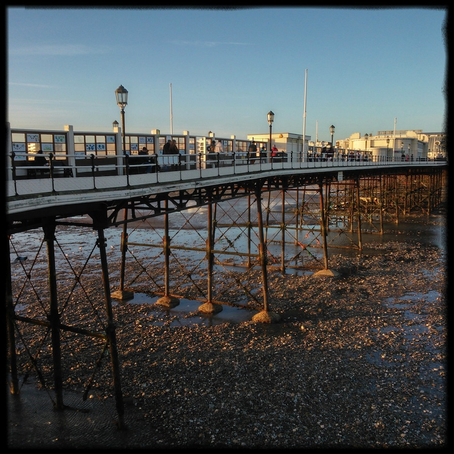 Worthing Pier walkway, spindly legs and big feet