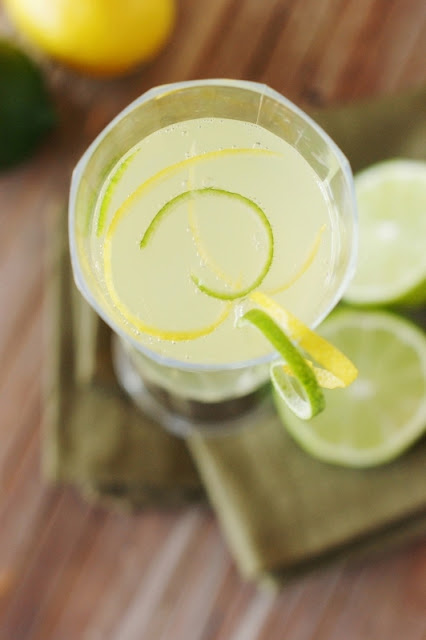 Sparkling Limoncello Cooler Garnished with Lemon and Lime Zest Image