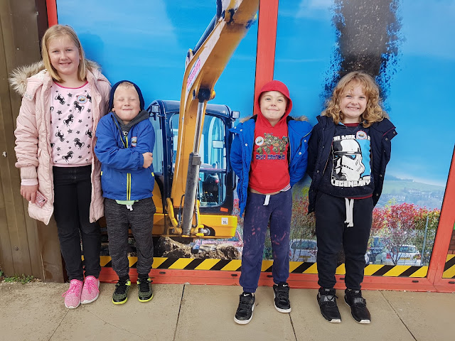 Midge,A,James and Will standing together at DiggerLand